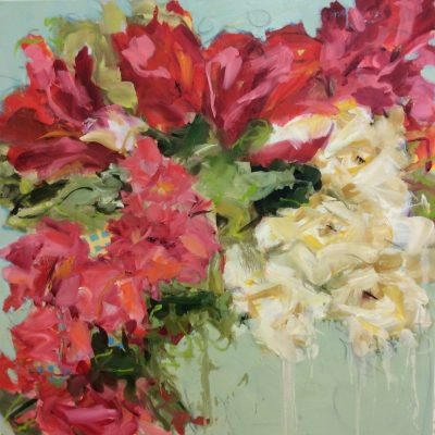 Art show at the Ponte Vedra Inn and Club featuring floral paintings by Phyllis Bachand.